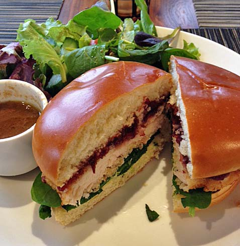 Hazelnut-crusted chicken sandwich with side salad